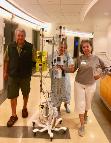 Movement equals life! Walking with Mom and Dad at the hospital.